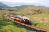 Historic engine Merddin Emrys and train in stunning Ffestiniog scenery